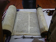 Torah scroll and silver pointer (yad) used in reading